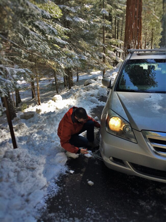 Chris Taylor putting on snow chains in Sequoia National Park 1