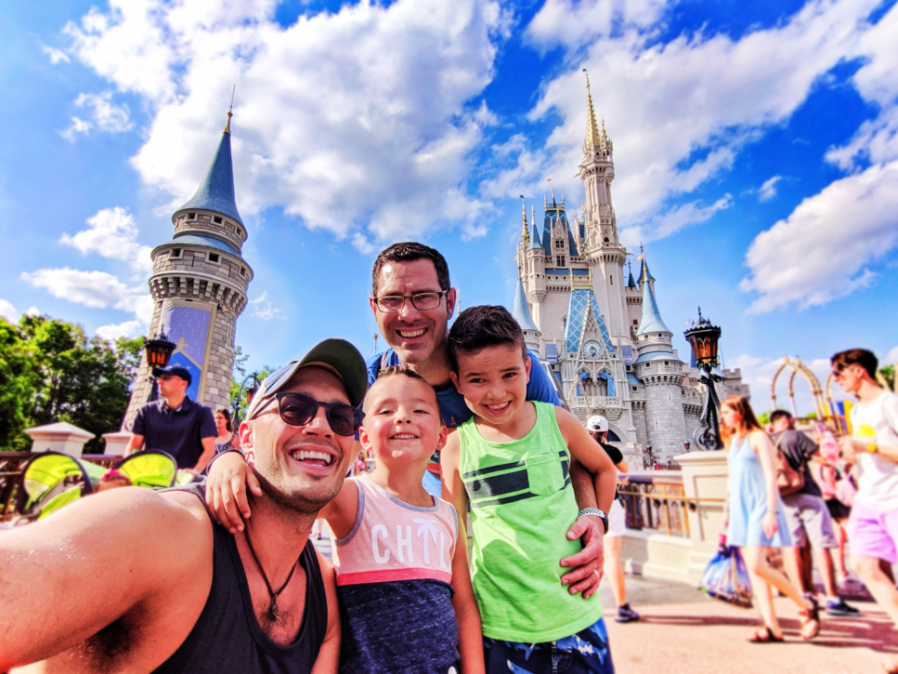 Full Taylor Family at Cinderellas Castle Magic Kingdom Disney World Florida 3