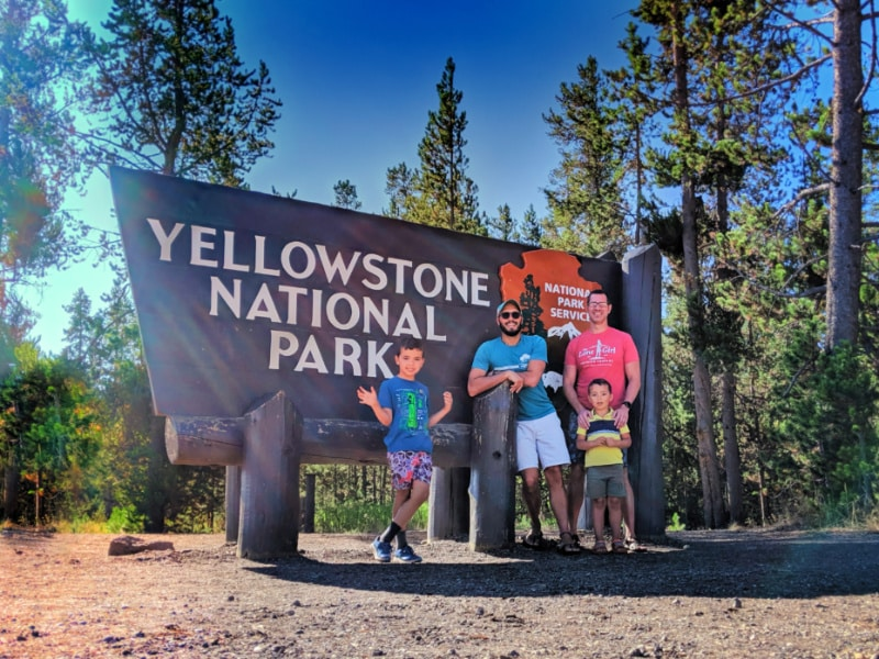 Full Taylor Family at Entrance Sign Yellowstone National Park 5