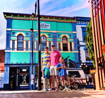 Full Taylor Family at Market Square with Colorful Victorian building Victoria BC 1