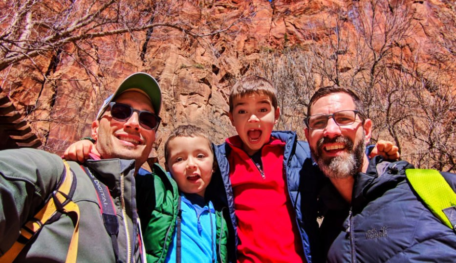 Full Taylor Family at Red Rock walls of Zion Canyon Zion National Park Utah 1