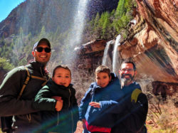 Full Taylor Family behind waterfall Emerald Pools trail Zion National Park Utah 1