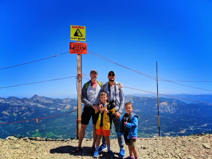 Full Taylor Family hiking at top of Lone Mountain at Big Sky Resort Montana 2