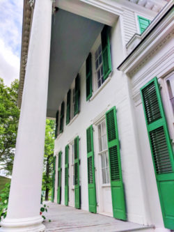 Green shutter front porch at masnion at Genesee Village Rochester New York 1