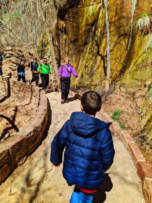 Hikers The Narrows on Riverwalk Trail Zion National Park Utah 4