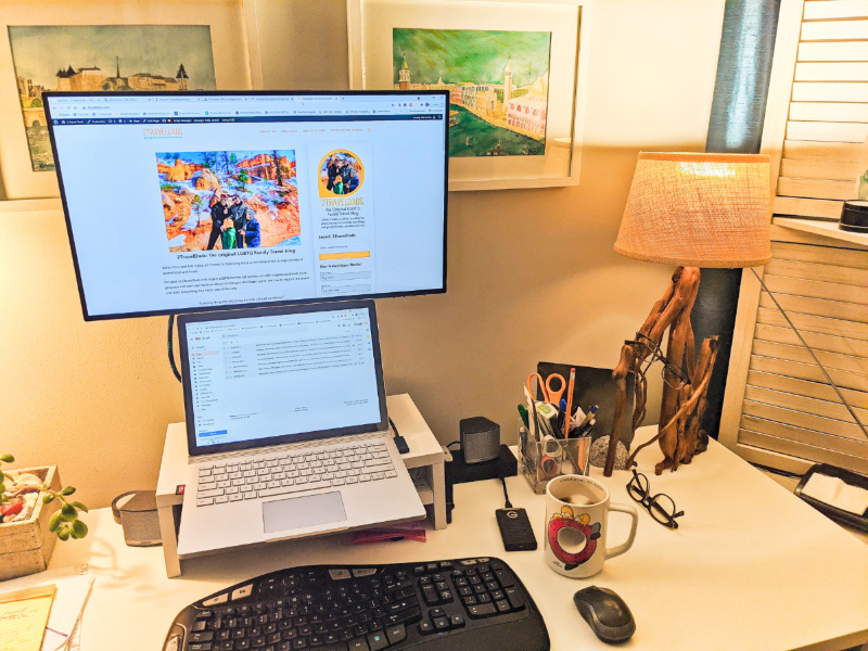 Home Office Setup with Extended Display and Desktop Speakers 1