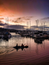 Kayakers and Reflections in marina sunset at Island Palms Best Western San Diego California 1