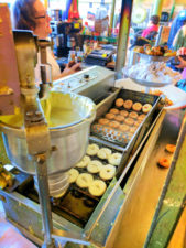 Mini doughnut stand in Pike Place Market Seattle 1