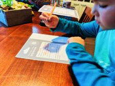 Oliver testing Ultimate Travel Journal for Kids 1