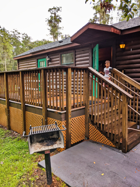 Outdoor Picnic Area with BBQ and Deck at Fort Wilderness Resort and Campground Cabin Disney World Orlando 1