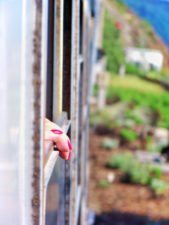Painted nails out train window on Tren Italia in Pisa Italy 1