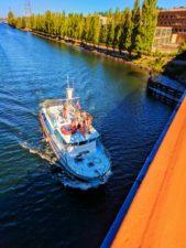 Party-Boat-in-Ship-Canal-under-Fremont-Bridge-Seattle-1-169x225.jpg