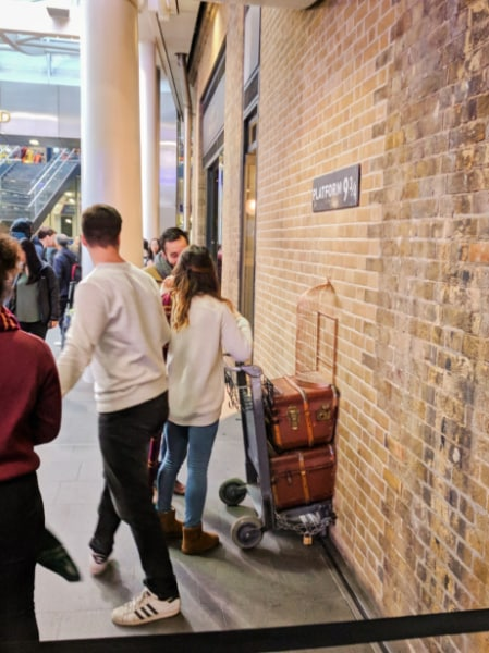 People Waiting for Pictures at Platform 9 34 in Kings Cross Station London 2