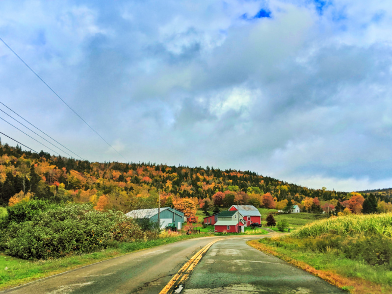 Red Barn and road with Fall Colors and clouds Pereaux Nova Scotia 1