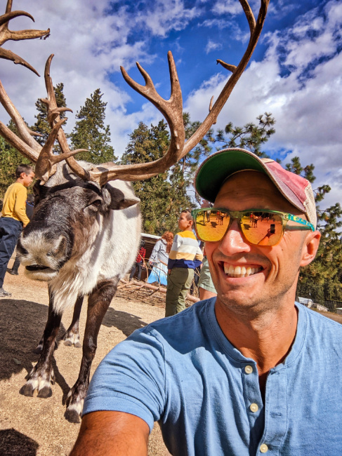 Rob Taylor Doing Reindeer Selfie at Reindeer Farm Leavenworth Washington 2