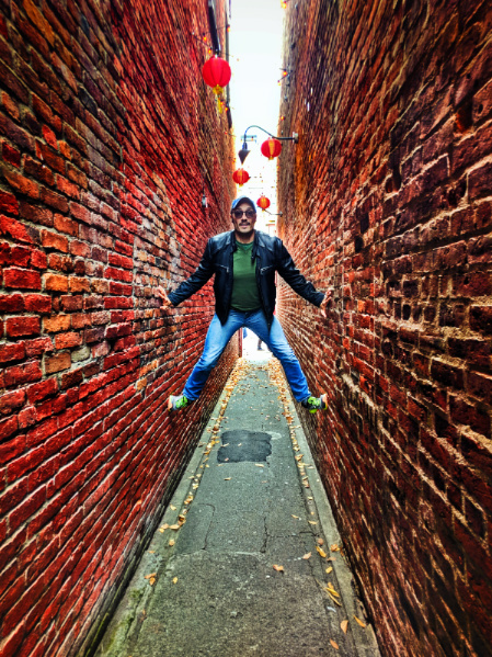Rob Taylor climbing the walls in Fantan Alley Chinatown Victoria BC 1