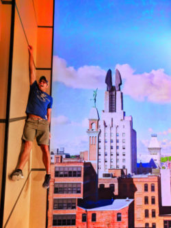 Rob Taylor hanging off building at Strong Museum of Play in Rochester New York 2