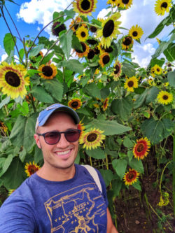Rob Taylor with Sunflowers at farm outside Rochester New York 1
