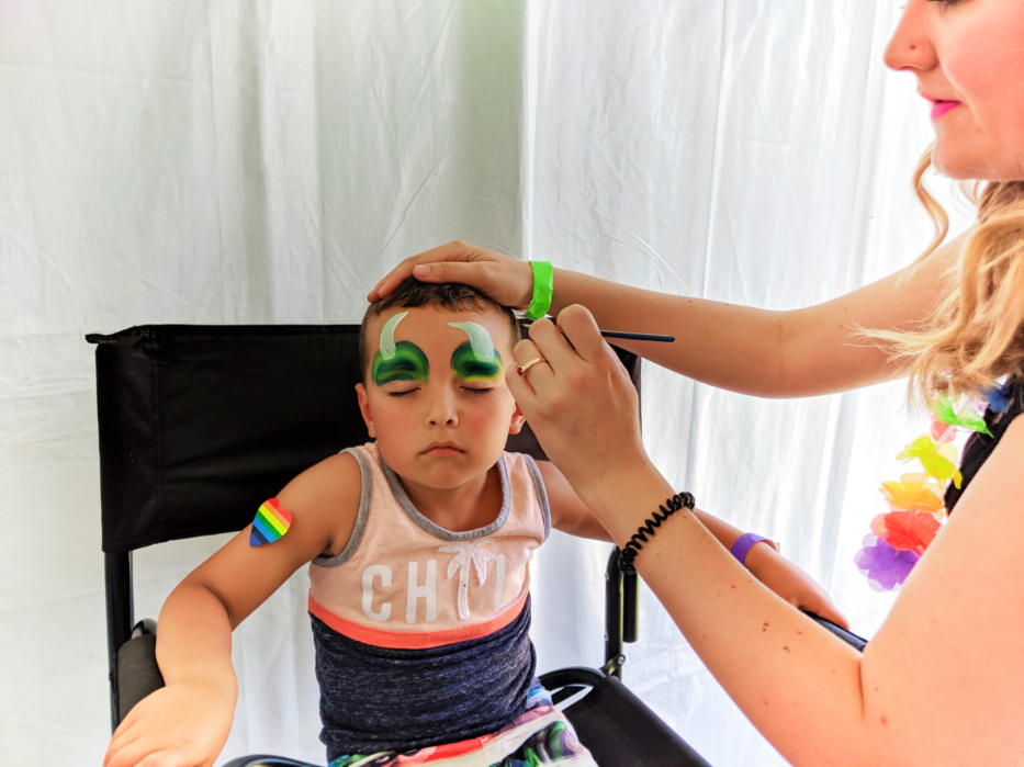 Taylor Family at San Diego Pride Festival facepainting in Childrens Garden Balboa Park SD California 2