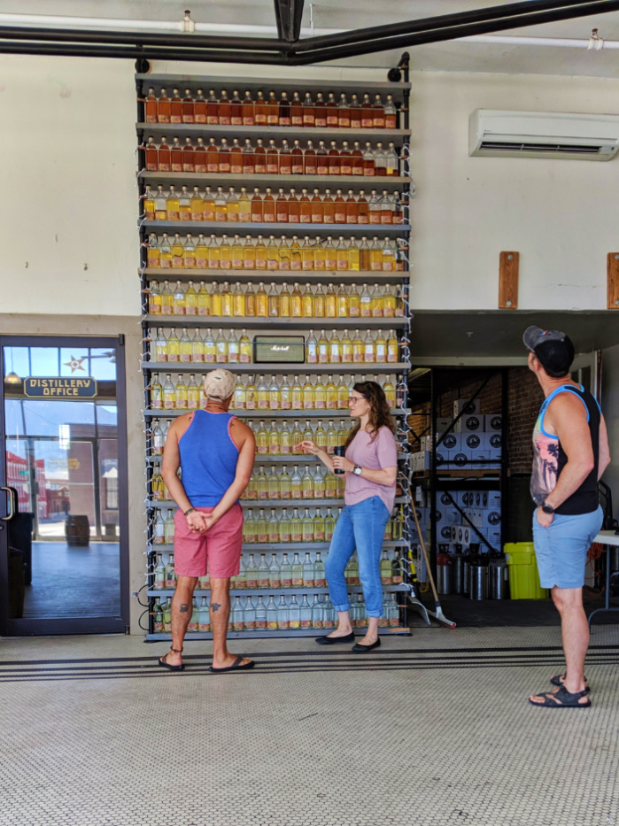 Taylor Family at Whiskey Aging in bottles wall at Headframe Spirits Butte Montana 1