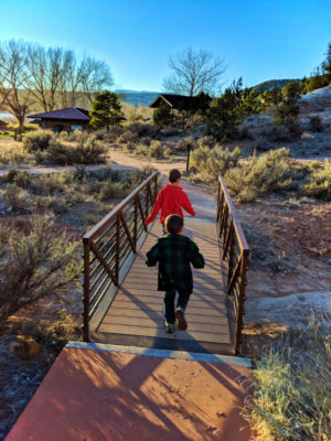 Taylor Family hiking at Petrified Forest State Park Escalante Utah 6