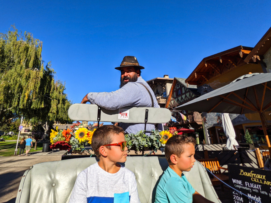 Taylor Family on Flower covered Horse Drawn Carriage Downtown Leavenworth Washington 2