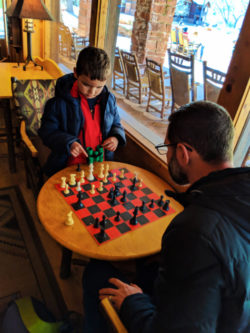Taylor Family playing chess at Zion Lodge Zion National Park Utah 2
