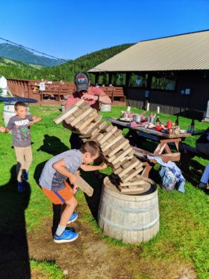 Taylor Family playing jenga at Riverhouse Grill on Gallatin River Big Sky Montana 1