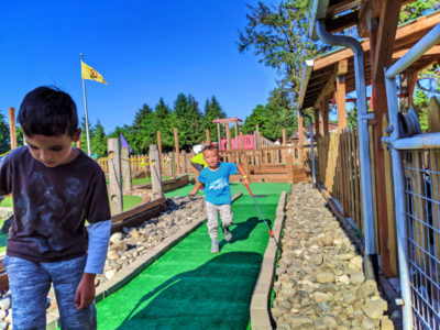 Taylor Family playing mini golf at Astoria KOA Campground Warrenton Oregon 4
