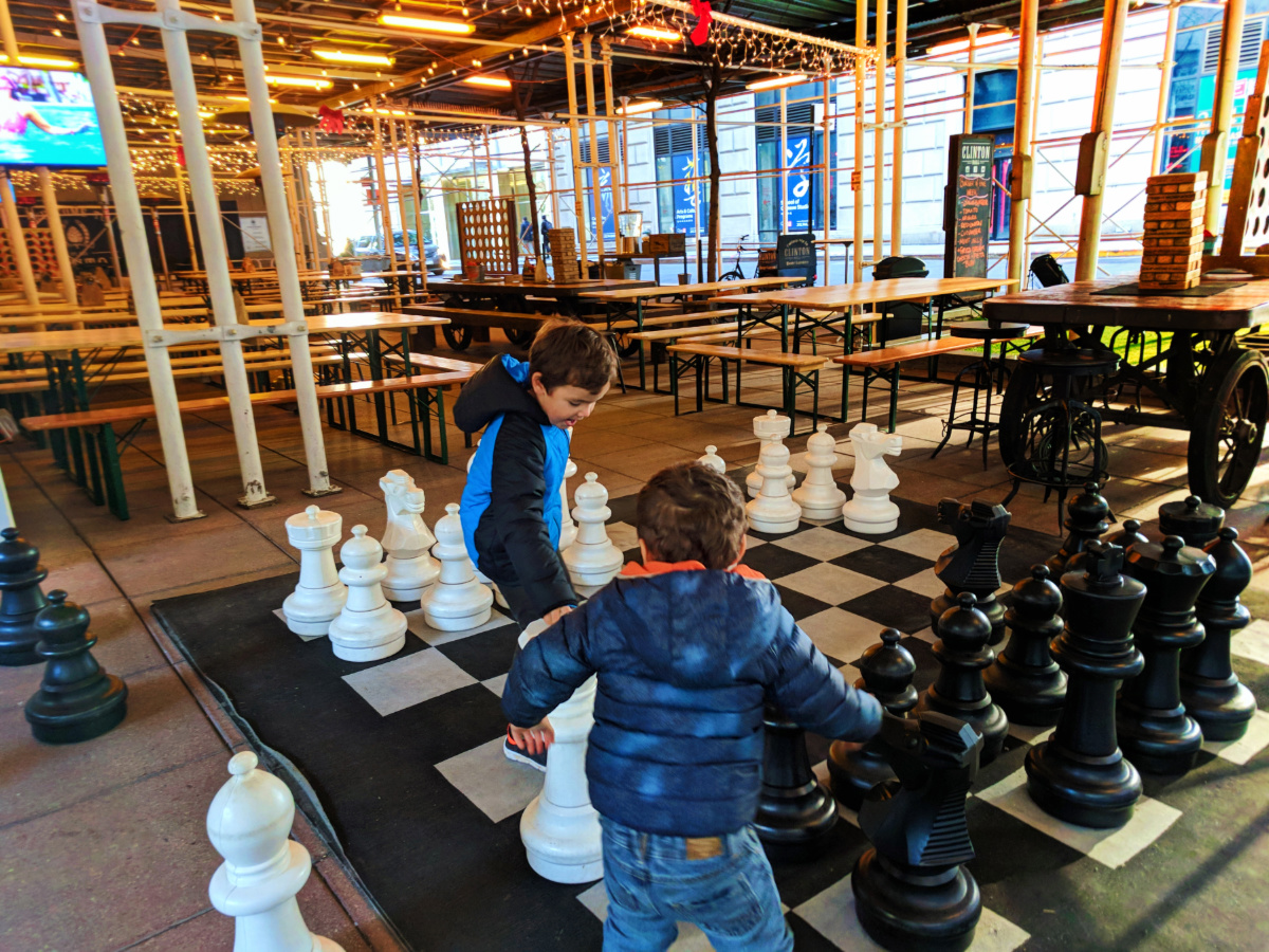Taylor Family playing oversized chess at Clinton Hall Lower Manhattan NYC with kids 2