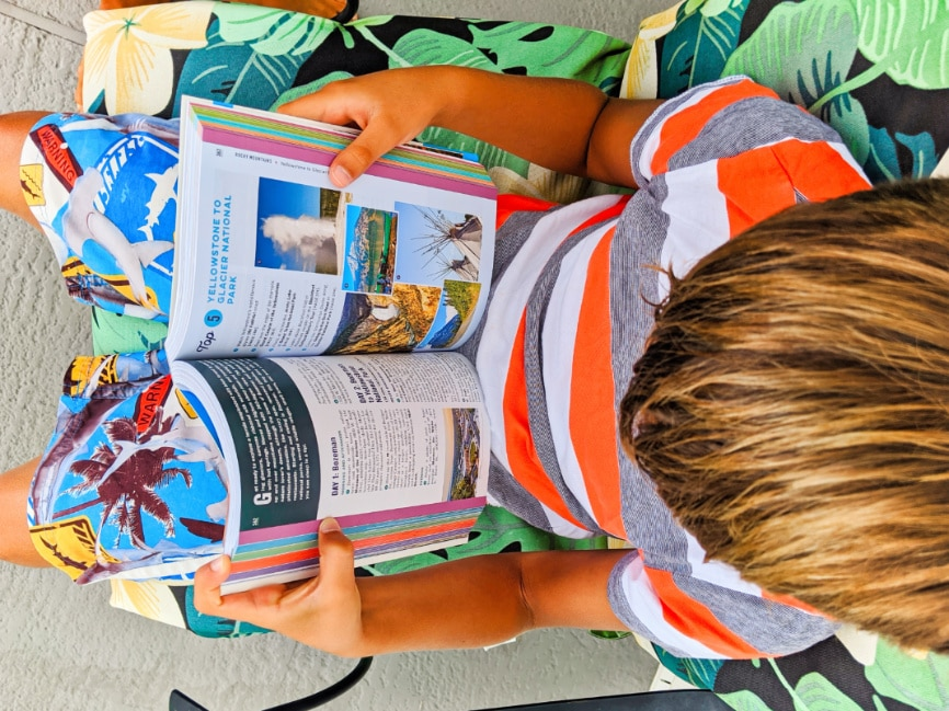 Taylor Family reading Moon Guides Open Road Best USA Road Trips 3