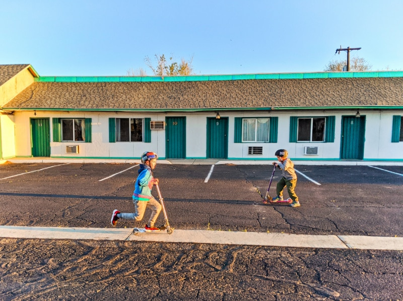 Taylor Family scootering at motel in Green River Utah cross country relocation 2020 3