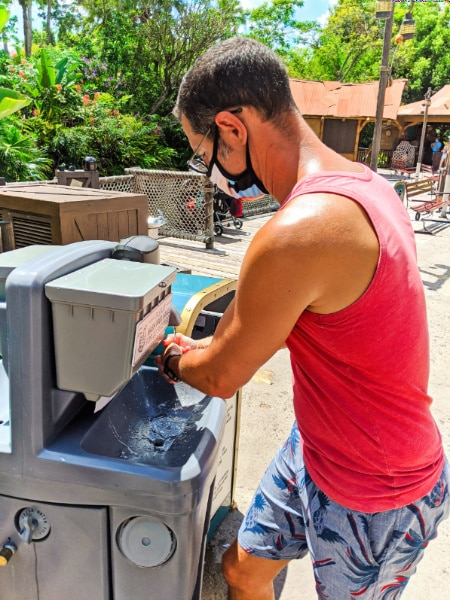 Taylor Family using Mobile Hand Washing Station in Magic Kingdom Walt Disney World 2020 1