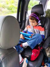 Taylor-Family-watching-movie-in-car-on-road-trip-Oregon-Coast-1-169x225.jpg
