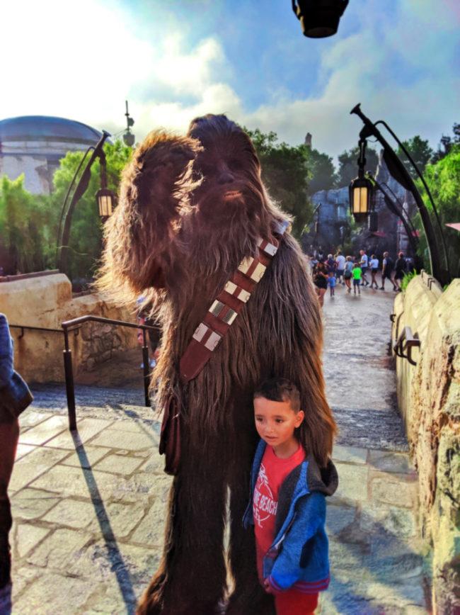 Taylor-Family-with-Chewbacca-Star-Wars-Galaxys-Edge-Disneyland-California-1-e1577634950867.jpg