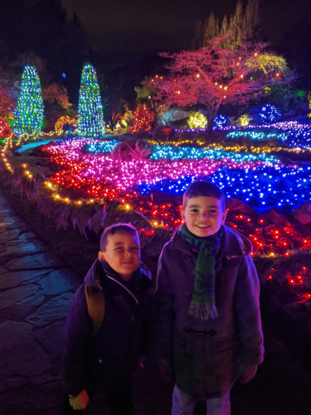Taylor Family with Christmas Lights in Sunken Garden at Butchart Gardens Christmas Victoria BC 2