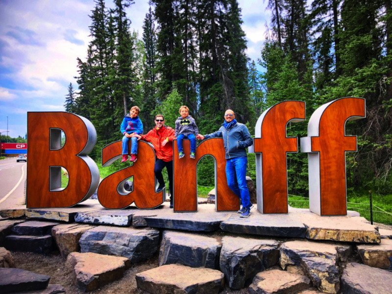 Taylor Family with Giant Banff Sign Banff National Park Alberta 1b
