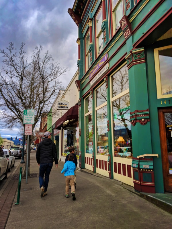 Taylor Family with Victorian building downtown Grants Pass Oregon 1