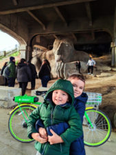 Taylor Kids with Seattle Troll LimeBikes bike sharing in Seattle waterfront 1