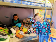 Taylor Kids with lots of toys 1