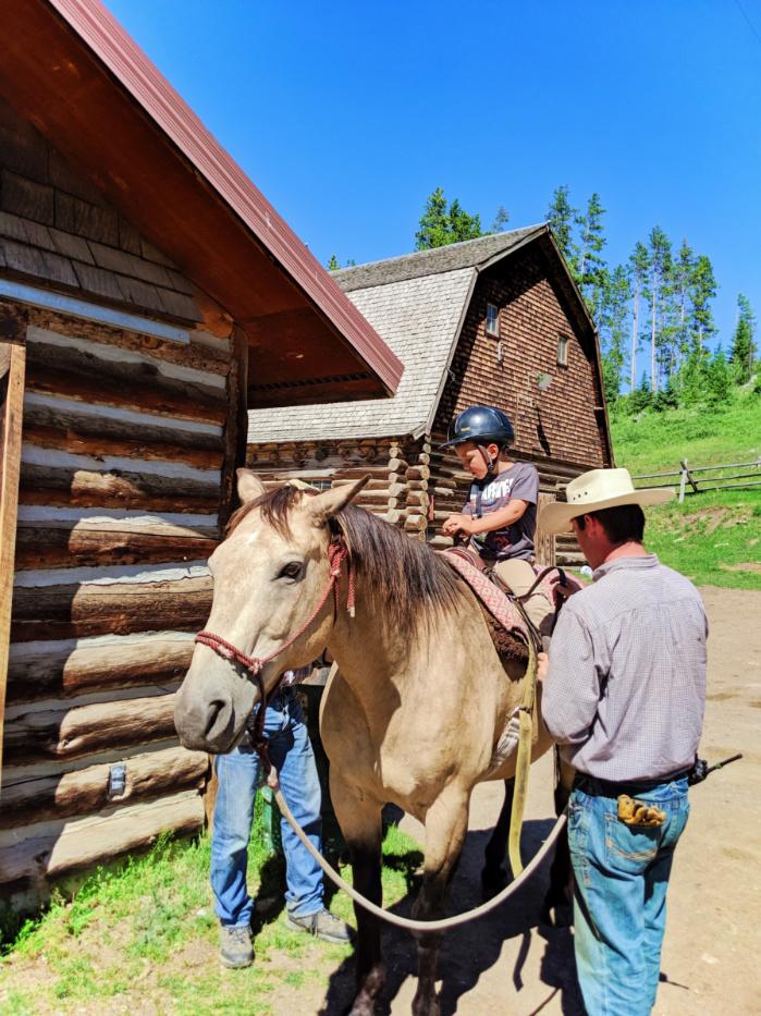 Taylor kids riding horses at 320 Guest Ranch Big Sky Montana 2