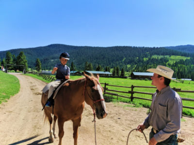 Taylor kids riding horses at 320 Guest Ranch Big Sky Montana 4