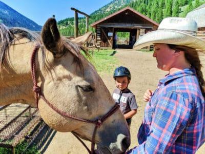 Taylor kids riding horses at 320 Guest Ranch Big Sky Montana 5
