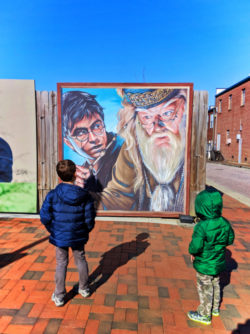 Taylor kids with Harry Potter street art in Marietta Square Georgia 1