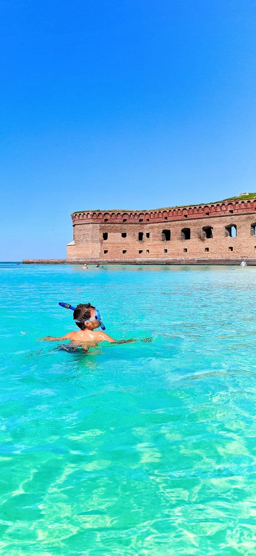 Snorkeling in crystal clear water at Fort Jefferson, Dry Tortugas National Park, Key West Florida