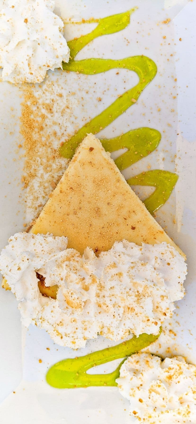 Best Key Lime Pie in the Florida Keys - pie with whipped cream and lime glaze