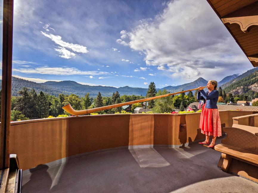 Woman Playing Alpenhorn at Enzian Inn Leavenworth Washington 1